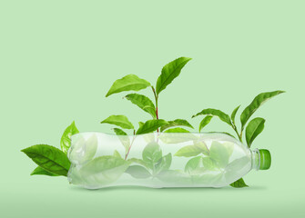 Obraz Bottle made of biodegradable plastic and leaves on green background - fototapety do salonu