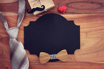Obraz top view image of fathers day composition with vintage father's accessories and blackboard - fototapety do salonu