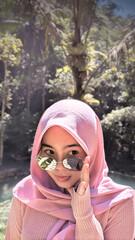 Fototapeta Close-up Of Young Woman Wearing Hijab And Sunglasses obraz
