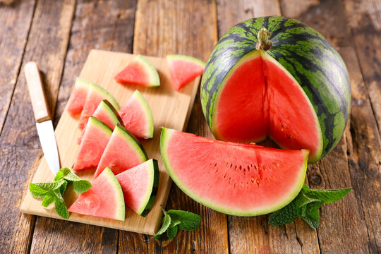 watermelon and cut on wooden board