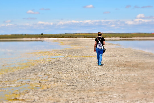 Walker. A person walking backwards through the lagoons of El Longar, in Lillo, town of Toledo in Spain