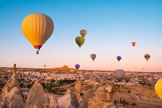 Hot air balloons making bright sky in Cappadocia, Turkey