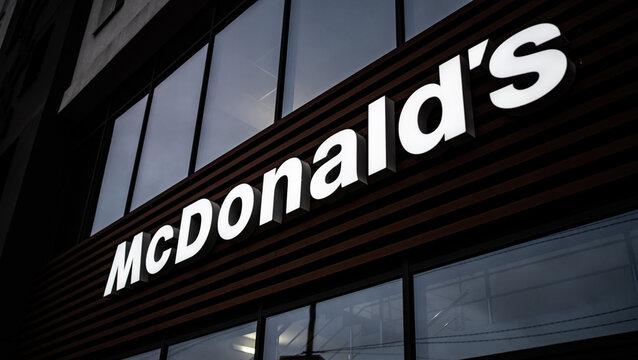 Kyiv, Ukraine - 05 Fabruary 2021: Black and white signboard of McDonalds restaurant closeup view