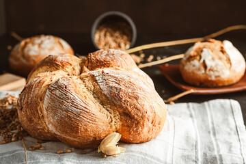 Obraz Bread on dark background. Fresh crispy baking, old style. - fototapety do salonu
