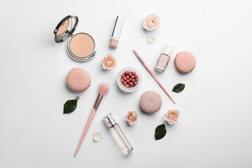 Obraz Flat lay composition with makeup products, roses and macarons on white background - fototapety do salonu