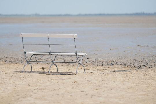 wooden bench on beach