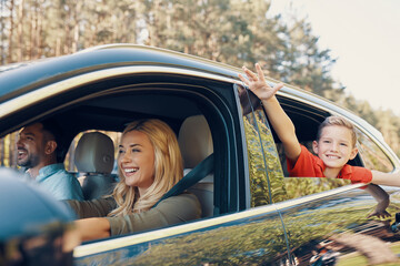 Young beautiful family with little boy having fun and smiling while driving in the car