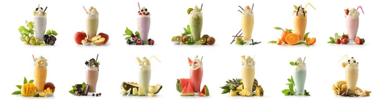 Set of milkshakes decorated with fruits of various flavors isolated