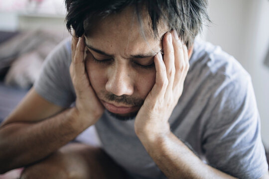 asian man have feeling stress in the bedroom, anxiety