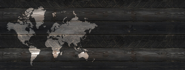 Obraz World map on black wooden wall background. Horizontal banner - fototapety do salonu