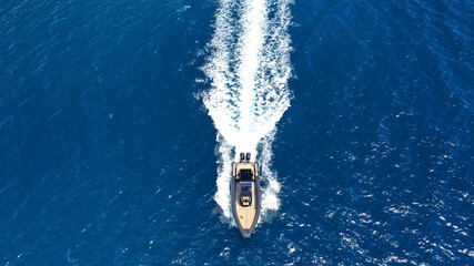 Aerial drone top down photo of luxury inflatable speed boat cruising in deep blue Aegean sea, Greece - fototapety na wymiar