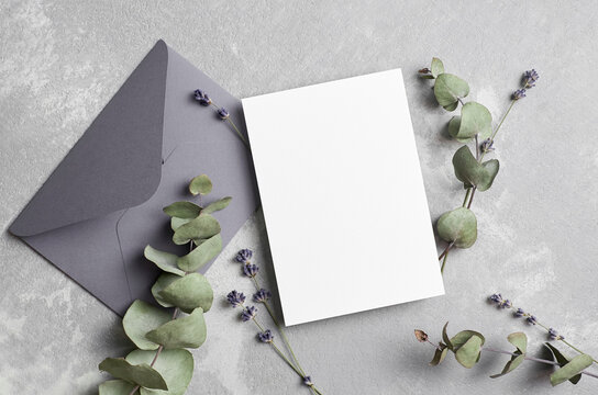Greeting or wedding invitation card mockup with envelope, lavender and dry eucalyptus twigs