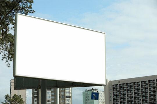 Blank advertising board in city. Mockup for design