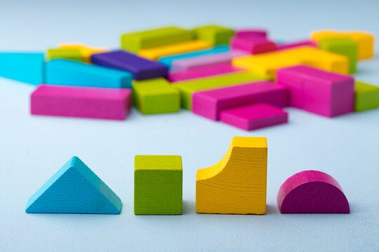 Wooden toy building kit details on blue background