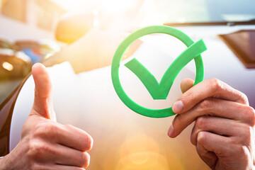 Fototapeta Businessperson Holding Check Mark Icon obraz