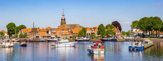 Panorama of historic village Blokzijl in summertime, with boats wating for the lock in the Netherlands