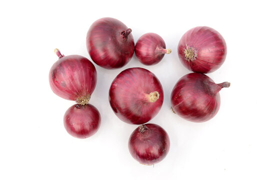 closeup bunch the ripe maroon onion isolated on white background.