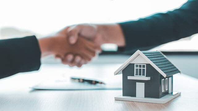 Business success, Real estate agents and customers shake hands to congratulate after signing a contract to buy a house with land and insurance, handshake and Good response concept.