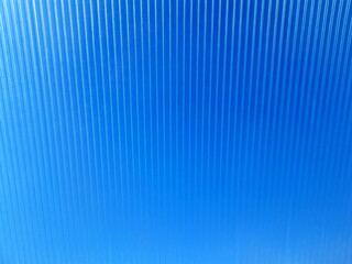 Bright blue background with vertical lines