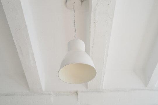 White metal plafond on the ceiling. Light interior, loft style.