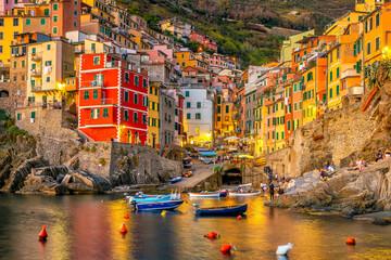 Riomaggiore,  Colorful cityscape on the mountains over Mediterranean sea in Cinque Terre Italy - fototapety na wymiar