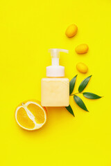 Obraz Bottle of natural cosmetics with citrus fruits on color background - fototapety do salonu