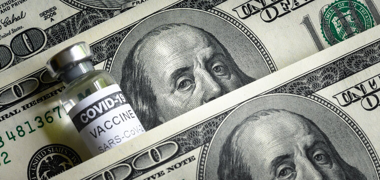 US dollar bills and COVID-19 vaccine vial. Corona virus vaccine price concept.