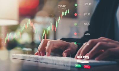 Obraz Stock exchange market concept, businessman trader type on computer keyboard with graphs analysis candle line in office room. - fototapety do salonu