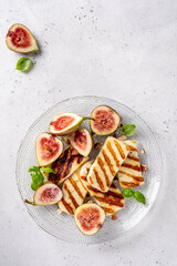 Grilled Halloumi Cheese, fresh figs fruit, almonds and honey