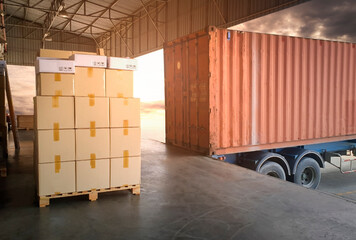 Stack of Package Boxes with Cargo Container. Trailer Truck Parked Loading at Dock Warehouse. Delivery Service. Shipping Warehouse Logistics. Cargo Shipment.  Freight Truck Transportation.