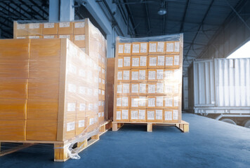 Stacked of Package Boxes Load into Cargo Container. Truck Parked Loading at Dock Warehouse. Delivery Service. Shipping Warehouse Logistics. Cargo Shipment. Freight Truck Transportation.