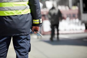 Fototapeta Police officer on the street in urban environment. obraz