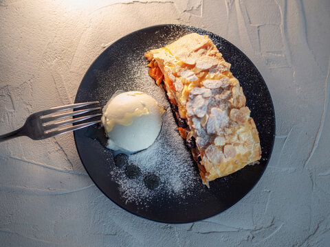 Delicious fresh strudel stuffed with apples and raisins,