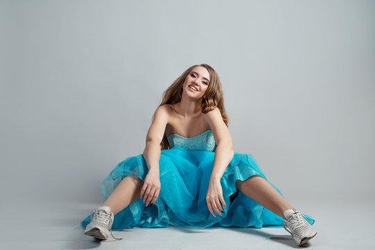 beautiful and daring princess in a lush blue Cinderella dress