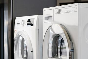 New washing machine in a home appliances store - fototapety na wymiar
