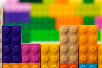 Colorful plastic toy building kit details close up