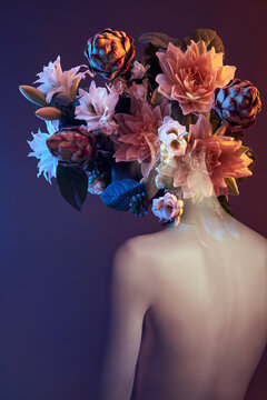 Beauty flowers face of a woman with double exposure. Portrait of a girl neon light and color, professional makeup, nude back of a woman, flowers in the head