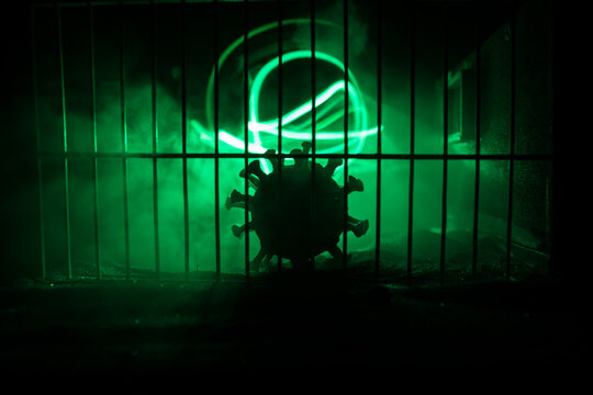 Prison or jail cell wall with window with bars, exterior perspective, COVID-19 corona virus disease pandemic outbreak, Coronavirus spreading among inmates, SARS-CoV-2 in correctional facility complex
