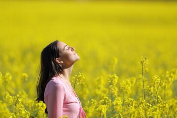 Obraz Relaxed woman breathing in a yellow field in spring - fototapety do salonu