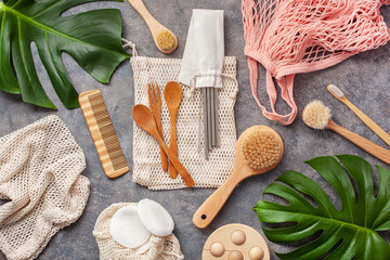 Obraz zero waste eco friendly concept. reusable cotton bag, stainless steel drinking staw, wooden cutlery toothbrush, cotton pads - fototapety do salonu
