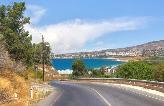 Curvy asphalt road leading to amazing sea bay. Cyprus