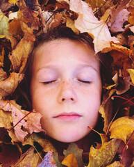 Fototapeta Close-up Of Girl Amidst Leaves During Autumn obraz