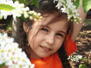Fototapeta Portrait Of Cute Girl With A Blossoming Cherry Tree obraz