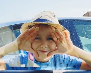 Fototapeta Portrait Of Smiling Boy In Summer obraz