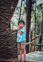 Fototapeta Portrait Of Girl Standing Against Tree obraz
