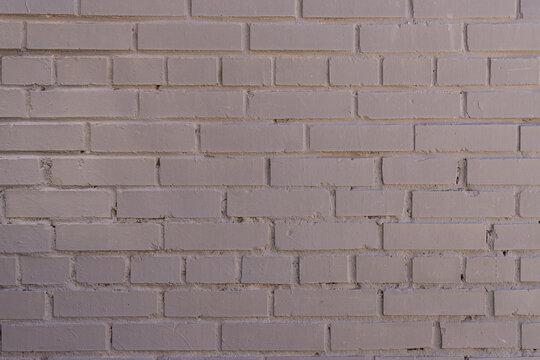 Grey painted brick wall background, textured backdrop. copy space for designers