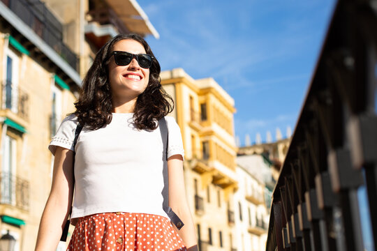 Young happy tourist woman visiting the Old Town in Donostia, Spain