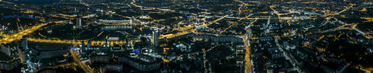 lights of the big city at night from above. wide panorama. aerial view. - fototapety na wymiar