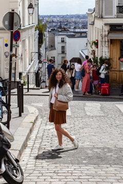 woman walking in the street in Montmartre