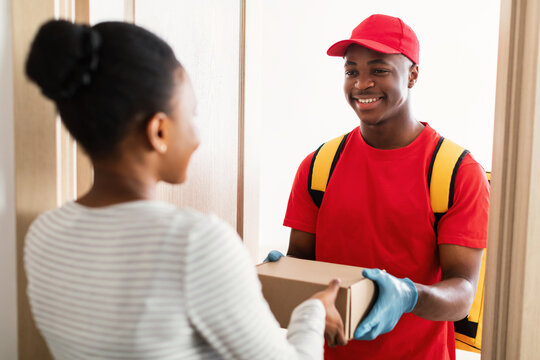 Courier Man Giving Box To Lady At Doors Of Home